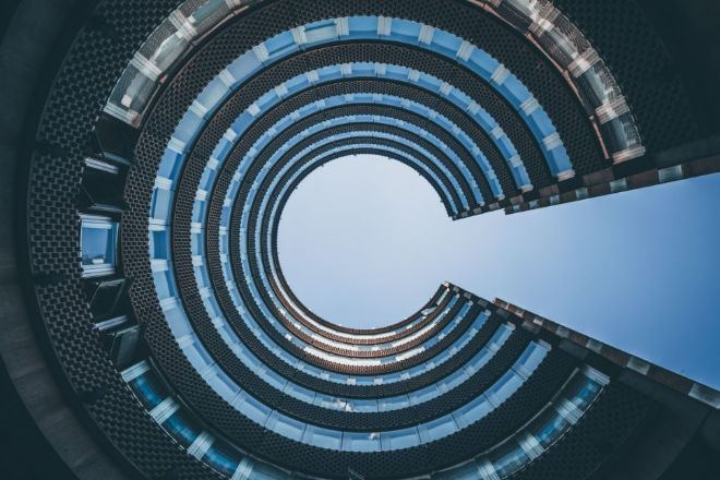 Image may contain: Blue, Architecture, Spiral, Circle, Sky.