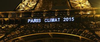 "Eiffel Tower in Paris with script ""Paris climat 2015"""