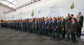All heads of delegation lined up for a group photo at COP 21.